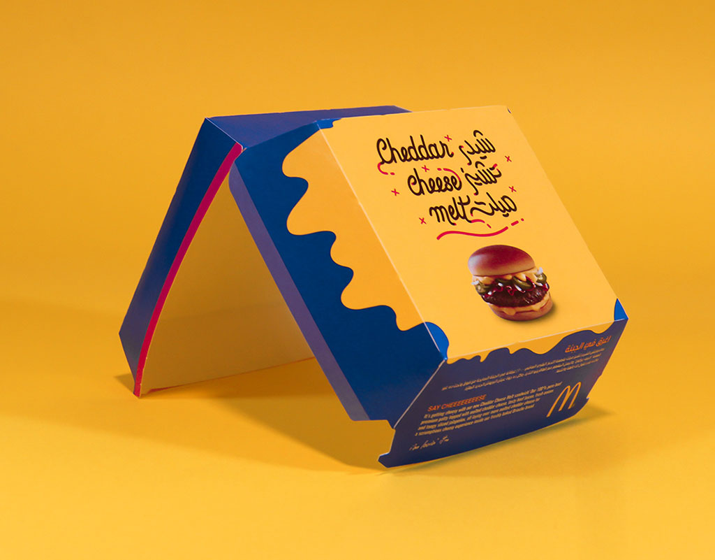 http://www.designbolts.com/wp-content/uploads/2017/12/Cheddar-Cheese-Melt-Mcdonalds-Burger-Packaging-Design.jpg