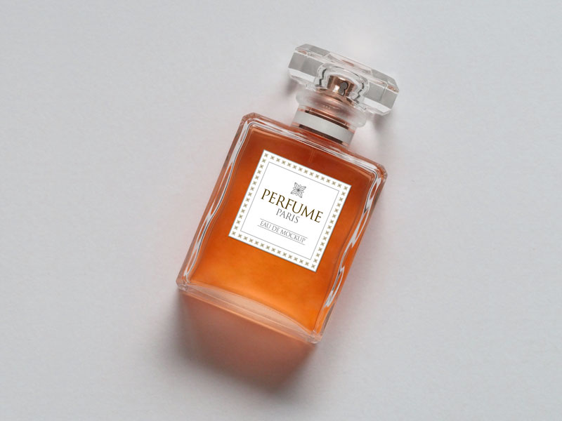Free-Scent-Perfume-Bottle-Mockup-PSD-orange
