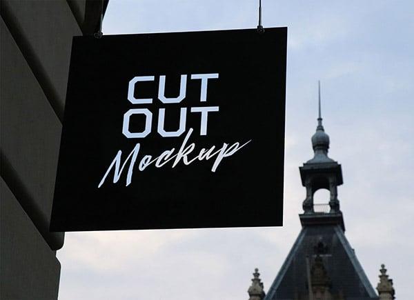 Free-Outdoor-Advertising-Cutout-Wall-Hanging-Shop-Sign-Board-Mockup-PSD