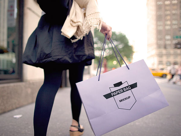 Girl-holding-Paper-Bag-Mockup-PSD