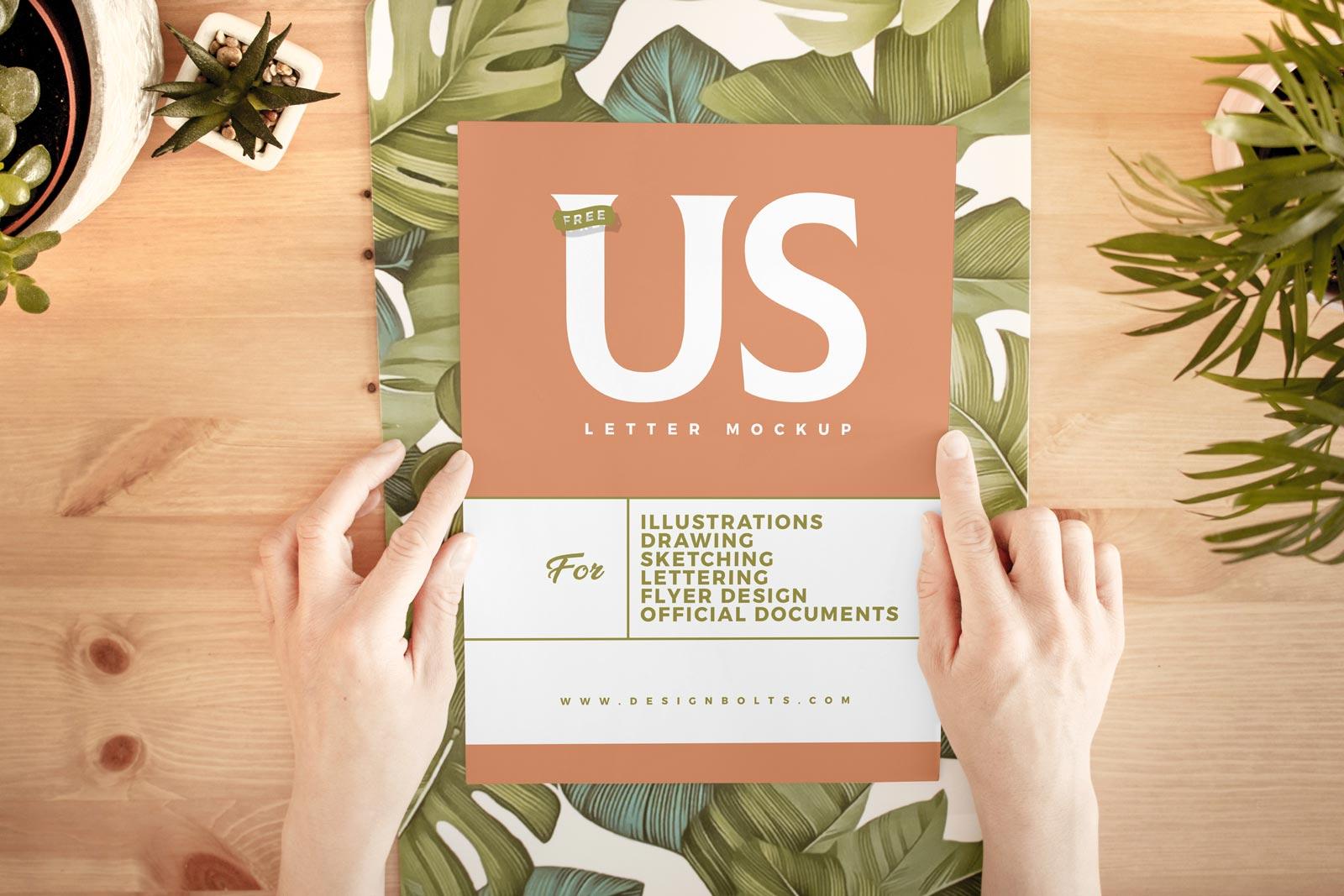 Free Hand Holding White Us Letter Paper Mockup Psd Designbolts